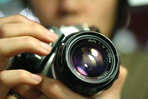 Close up of a photographer holding camera