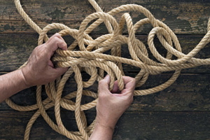 Man sorting through rope releasing any knots