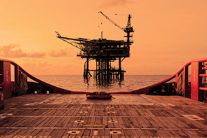 Silhouette of oil and gas rig platform at sunset