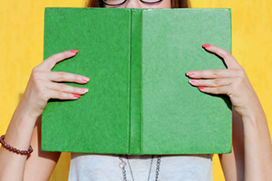 Woman sniffing book