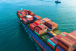 Aerial view of a container cargo ship importing goods
